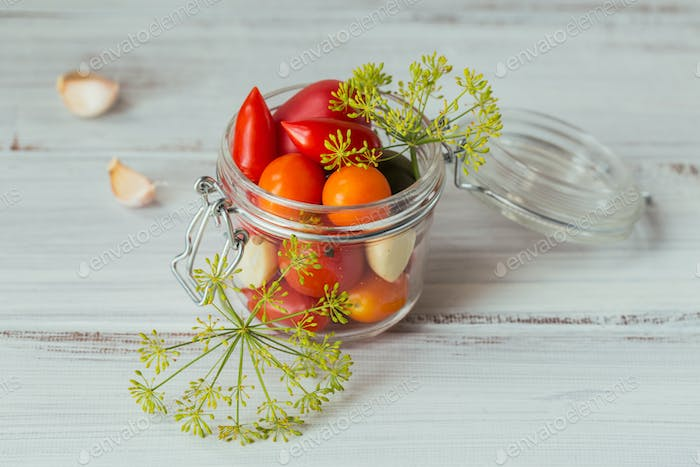 Ingredient for pickles tomatoes with dill on the kitchen table in rustic style