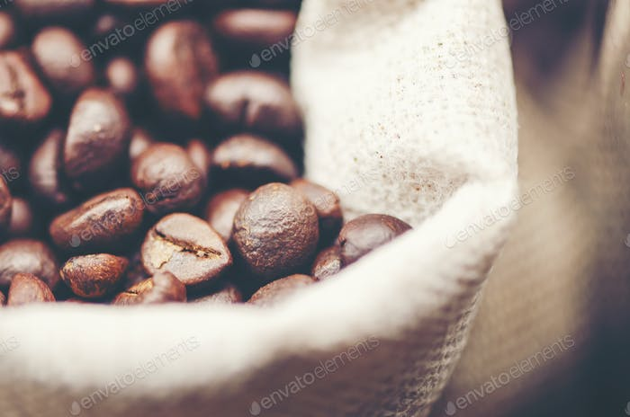 coffee beans on wooden background, arabica coffee, vintage filter image
