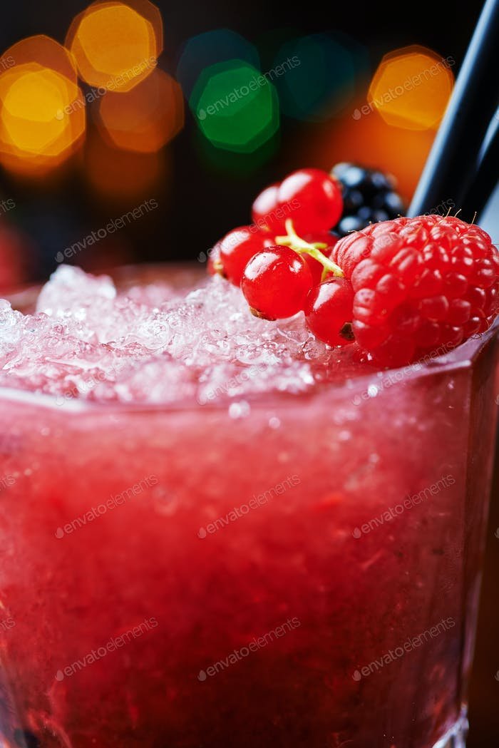 beautiful and tasty berries cocktail or lemonade with a nice bokeh. soft focus.