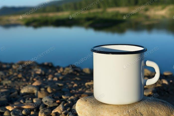 White campfire enamel mug mockup with blue river