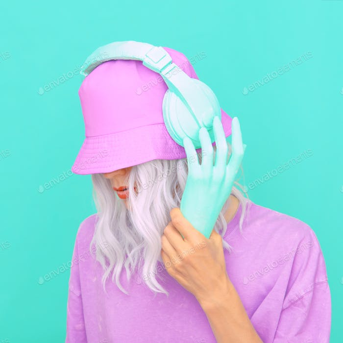 Fashion Dj Girl in stylish headphones and bucket hats.