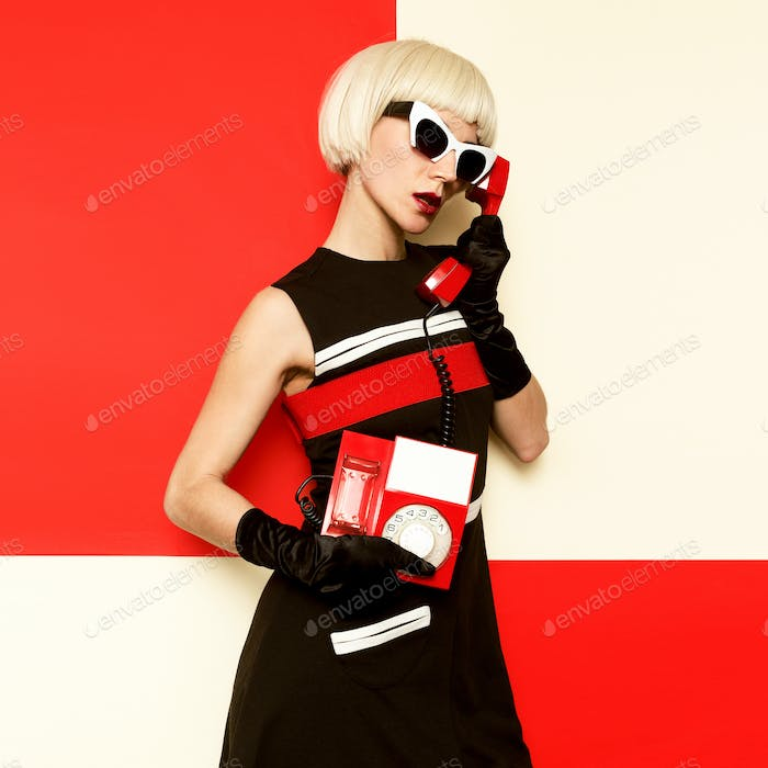 Elegant Retro Blonde in vintage clothes and retro telephone. Min