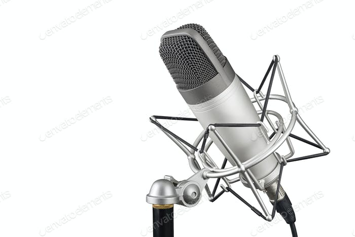 Silver studio condenser microphone in shock mount clip isolated on white background