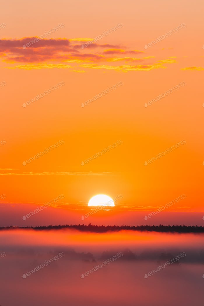 Amazing Sunrise Over Misty Landscape. Scenic View Of Foggy Morni