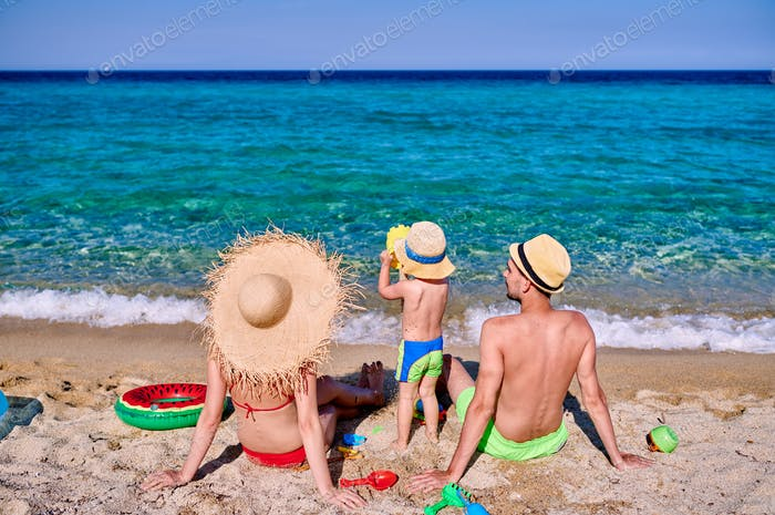 Family on beach in Greece