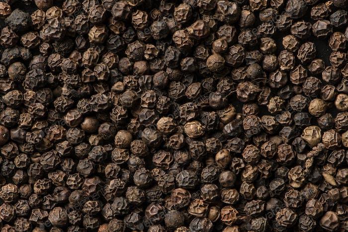 Black peppercorns background