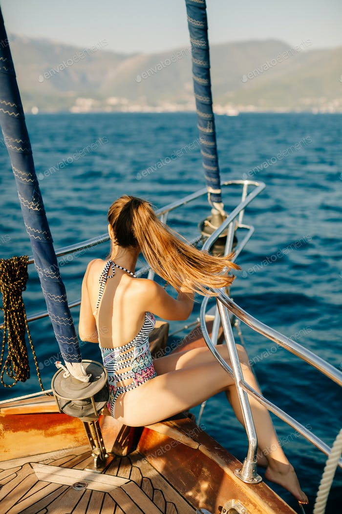 sexy woman sail on yacht
