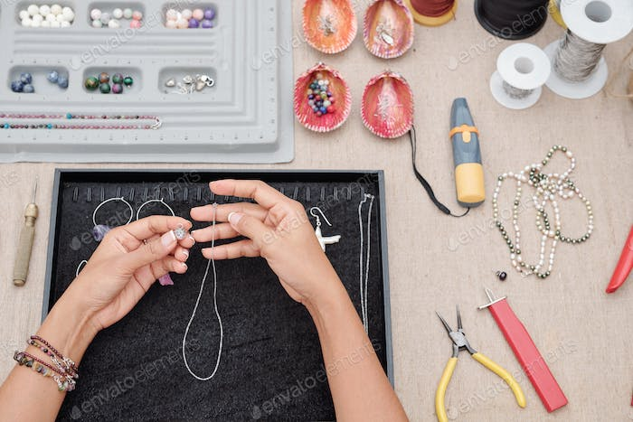 Woman making necklace
