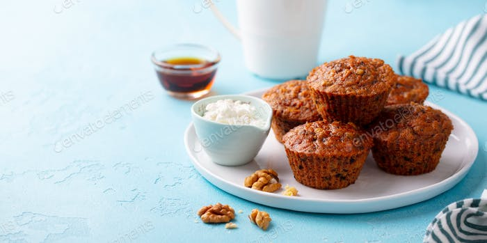 Carrot Muffins with Riccota Cheese on a Plate. Blue Stone Background. Copy Space.