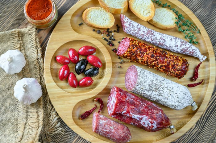 Assortment of salami with appetizers