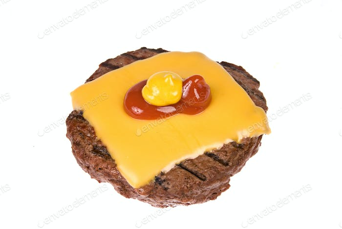 Hamburger patty with cheese, mustard and ketchup