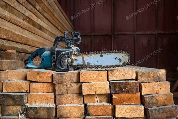 Chainsaw on lumber background