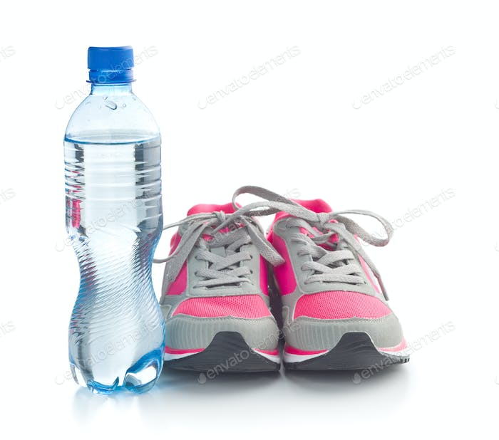 Sports shoes and a bottle of water.