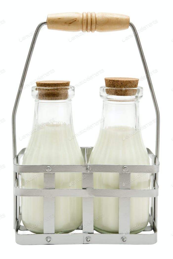 Two Milk Bottles Isolated on a White Background