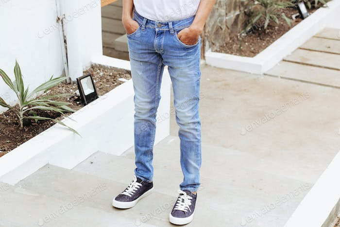 Man with denim pants