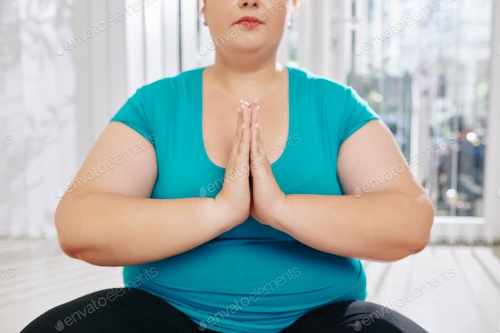 Meditating overweight woman