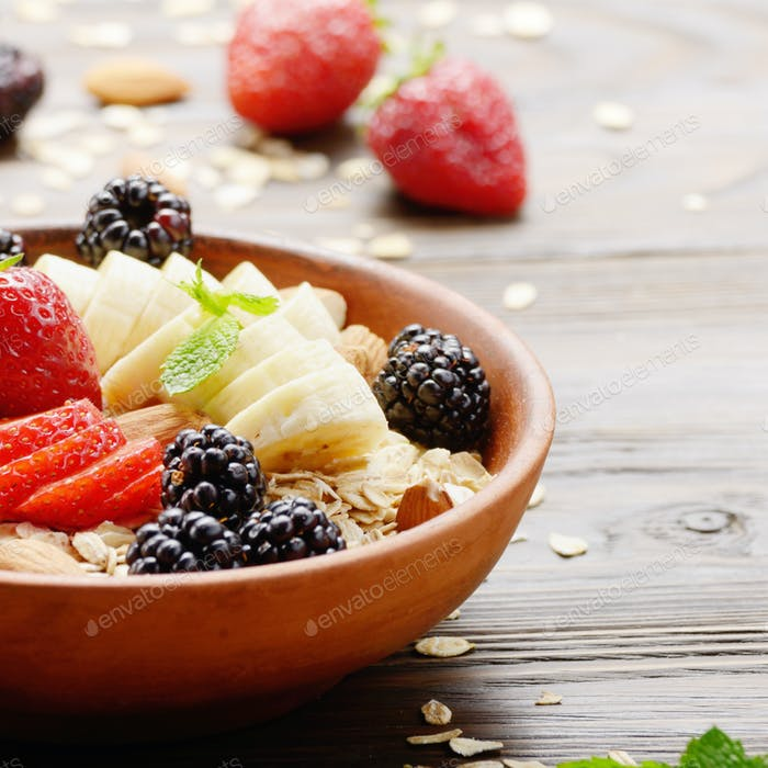 Fruit healthy muesli with banana strawberry almonds and blackber