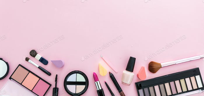 Make up cosmetics products against pink color background, banner