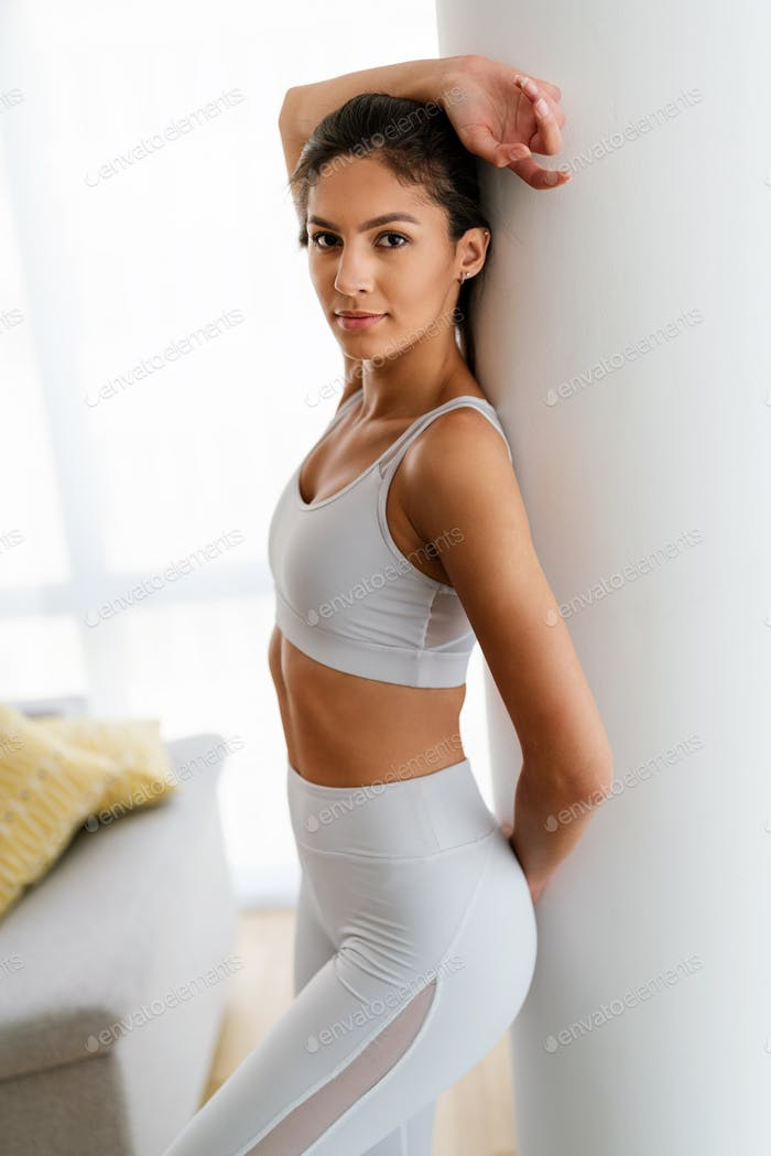 Portrait of sensual beautiful fit woman. Health, sport, beauty people concept