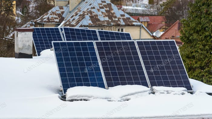 Solar panels on the snow covered roof