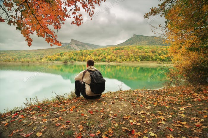 Man sitting alone on the pond.