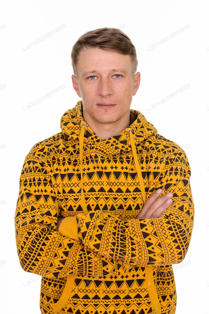 Studio shot of young handsome Caucasian man isolated against whi