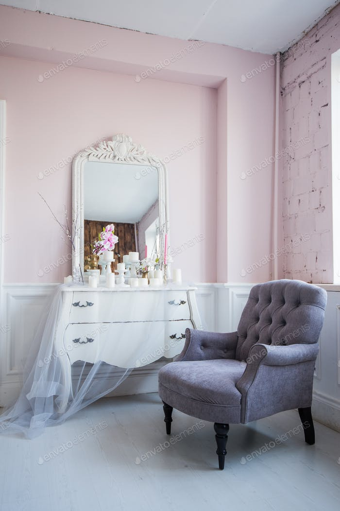 Classical armchair and mirror table at living room interior