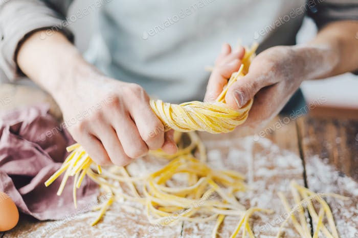 Chef making fresh italian pasta