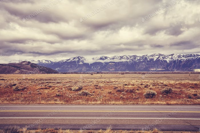Vintage toned scenic road in the Grand Teton National Park, USA.