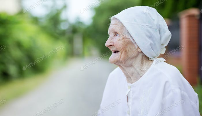 Happy senior woman looking up outdoors