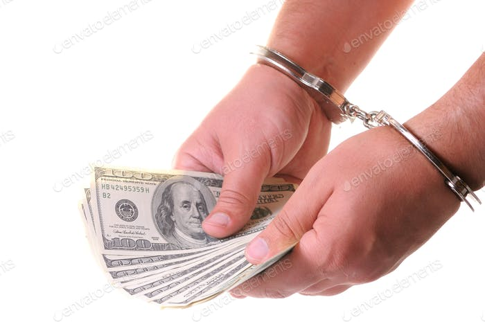 Mans hands in closed metal handcuffs counting american dollars