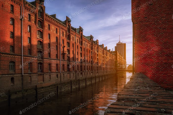 Speicherstadt warehouse district during sunset in Hamburg, Germany. Old brick buildings of Hafencity