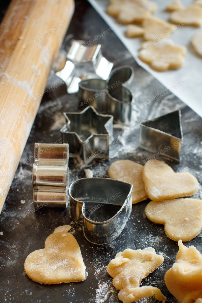 Close up of cookie cutters and rolling pin