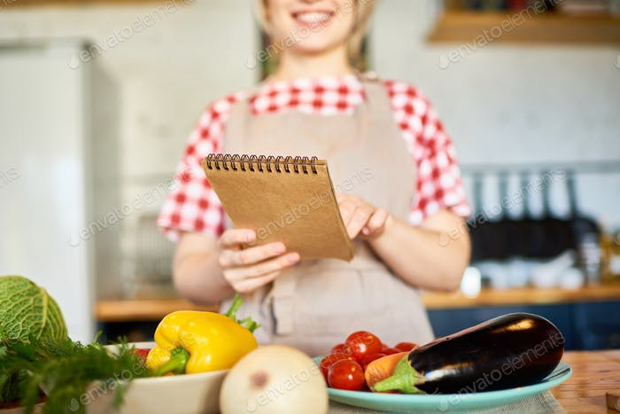Young Woman Reading Recipe