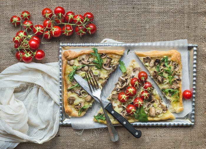 Ristic mushroom (fungi) square pizza with cherry tomatoes and ar