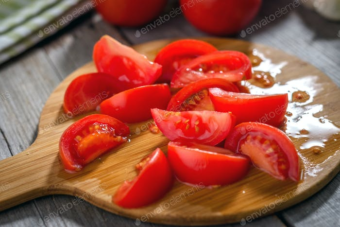 Fresh tomatoes  on a rustic  background