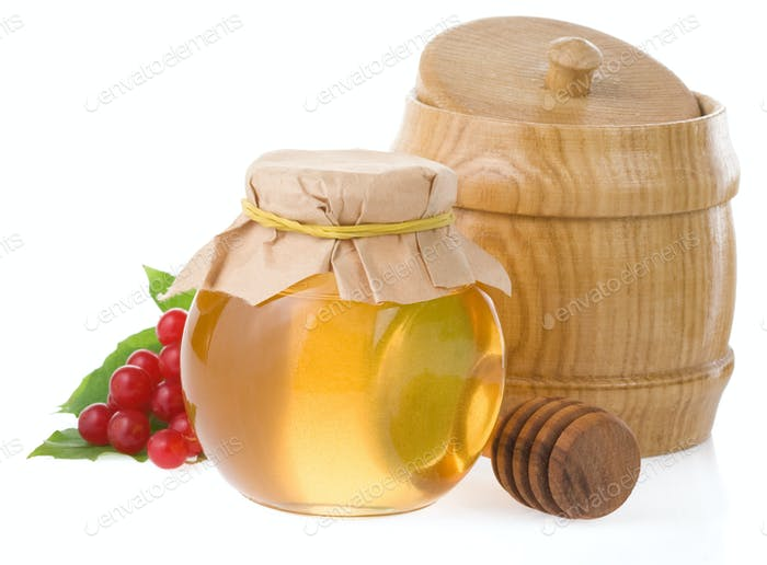 jar of honey and berry isolated on white
