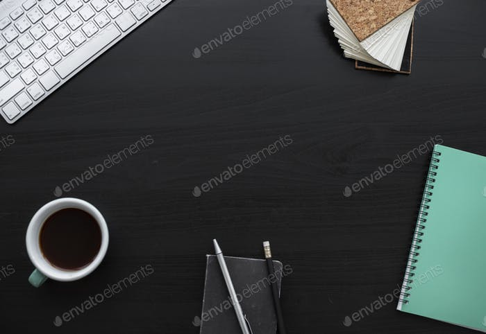 Notebook Pencils Coffee Cup Workspace on Black Table