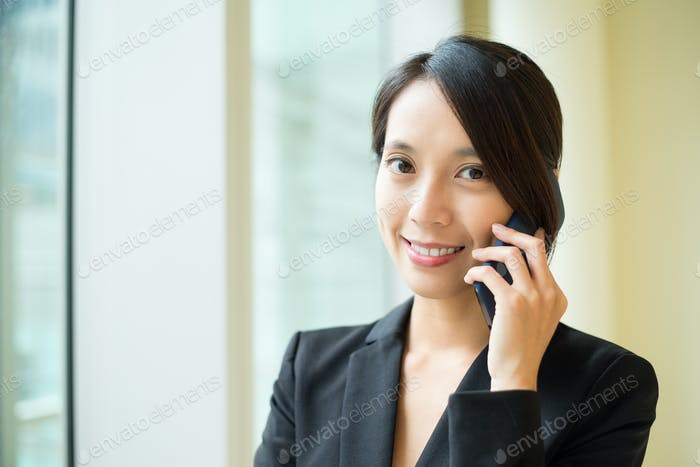 Businesswoman talk to cellphone at office