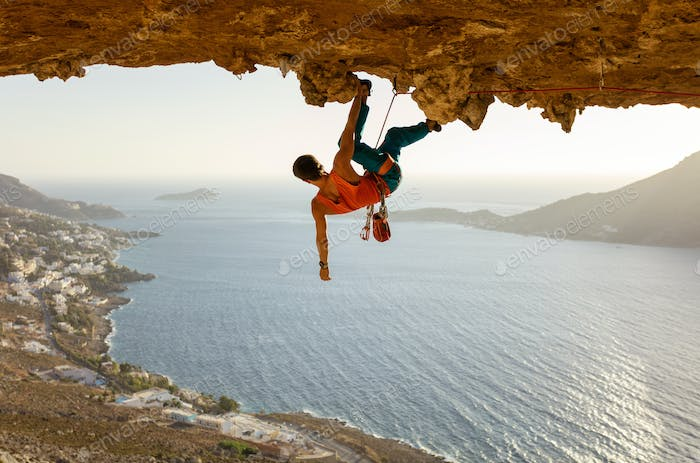 Male rock climber on challenging route