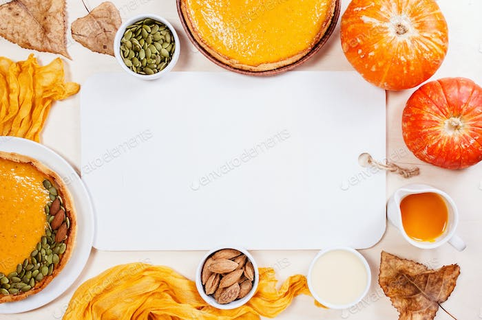 White Background with Pumpkin Pie and Wooden Cutting Board