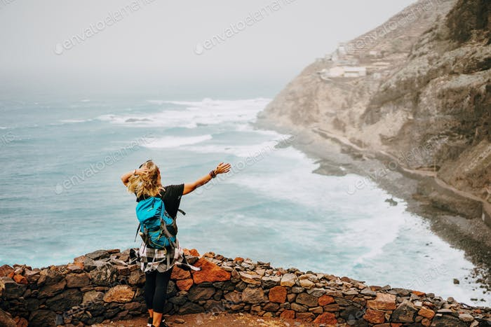Santo Antao Island, Cape Verde. Tourist female enjoying view of atlantic ocean coastline on hiking
