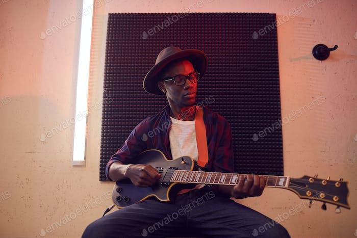 African American Man Playing Guitar
