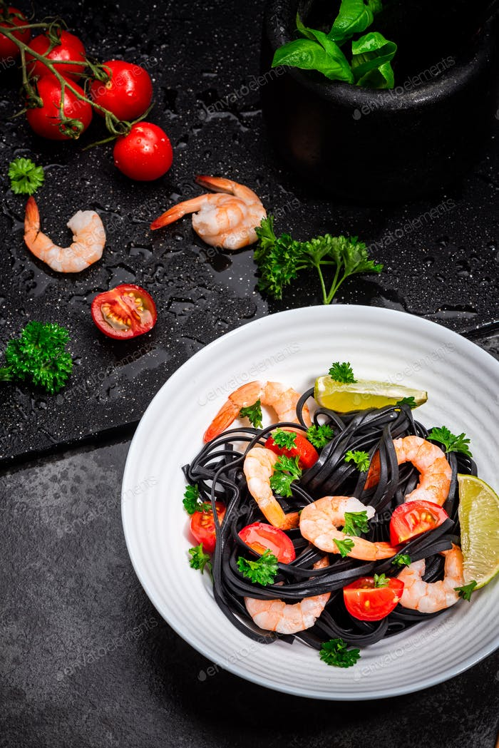 Squid Ink Pasta With Seafood, Herbs, Cherry Tomatoes. Black Spaghetti, Black Organic Noodles