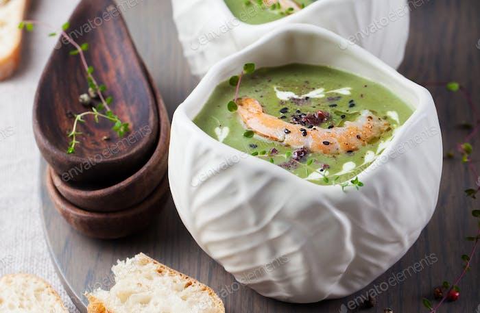 Broccoli, spinach cream soup, shrimp, wooden board