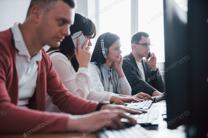 Corporate business. Young people working in the call center. New deals is coming