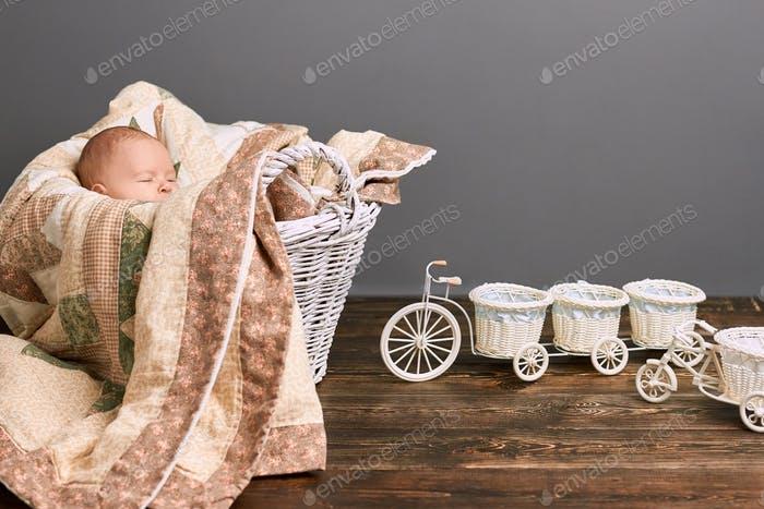 Baby with closed eyes, blanket