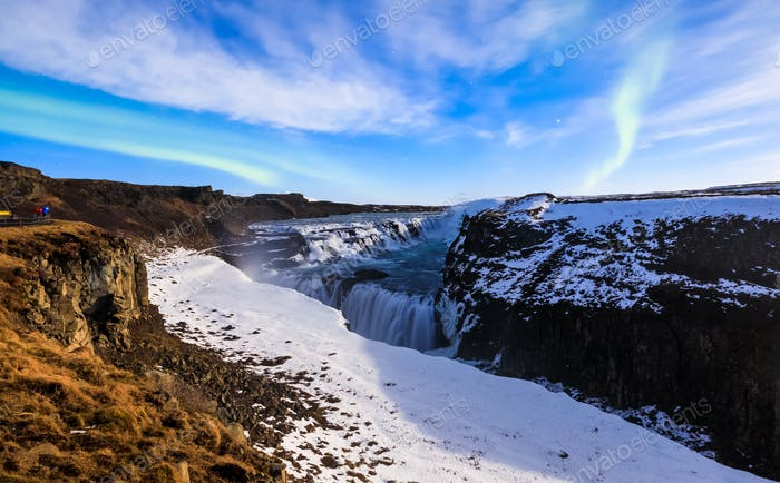 Gullfoss waterfall with Aurora borealis at night in full moon light, Iceland