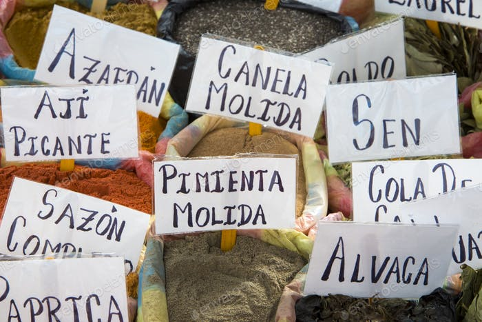 Bags of spices with signs and names of spice in Indian market