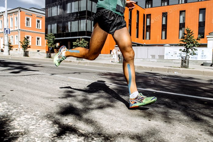 Legs Men Marathon With Taping on Calf Muscles